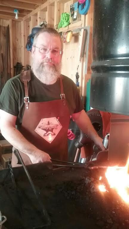 Showing off his new leather apron.