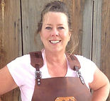 April Witzke the owner of Forge-Aprons wears a blacksmith apron for show and tell