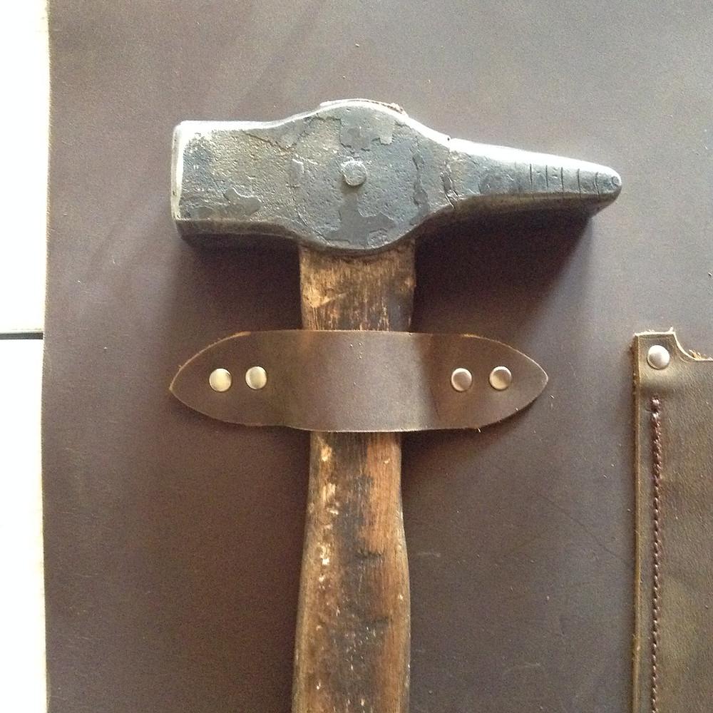 Tool Loop holding hammer