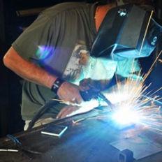 Metal sculptor David Norrie teaches welding at his blacksmithing school