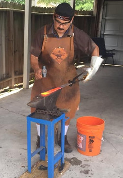David Reyes forging a blade in his leath