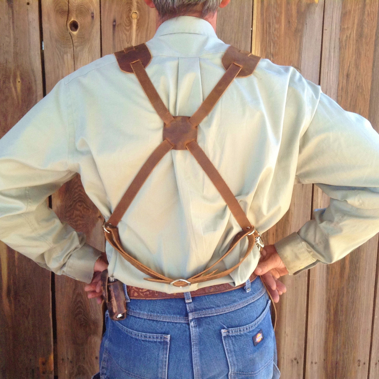 On the X system, he weight of the leather apron is supported mostly from the shoulders. The square piece is adjustable changing how the fit feels.