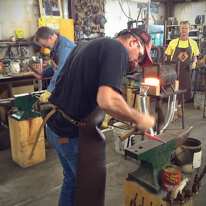 learnng to forge iron at Blacksmith Adventures