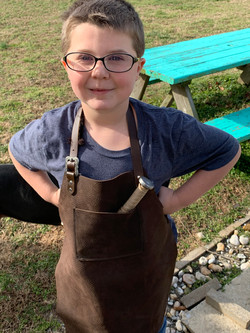 Budding bladesmith wears his Large size