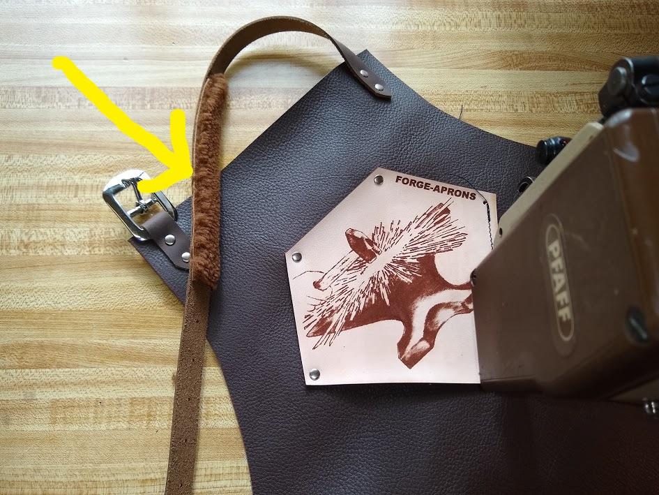 padded neckstrap on shop apron