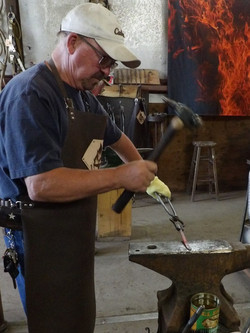 Hammering the steel