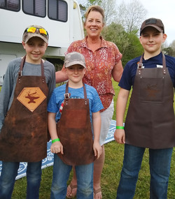 Boys in Forge-Aprons at BlacksmithGather