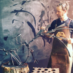 Sculptor Jake James in leather apron
