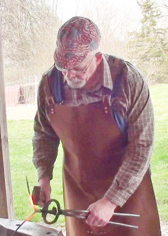 Bill does demonstrations at a historic blacksmith shop so he needed something without any flash.