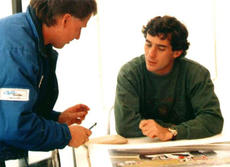 With Ayrton Senna, print signing 'Home Town Hero', Silverstone 1991.