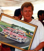 BBC TV & Radio star Mike Smith with the painting of his BTCC Sierras. Thruxton 1989.