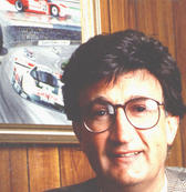 Eddie Jordan in his office at Silverstone in 1990, with the painting presented to him by Martin Donnelly on the wall.