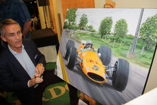 Martin Whitmarsh signs the Bruce McLaren Spa '68 painting, BRDC Silverstone
