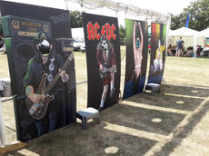 Painted Fun Faceboards at a music festival.