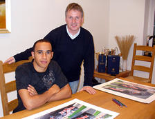 With Lewis Hamilton in 2007, signing the prints 'North American Dream'.