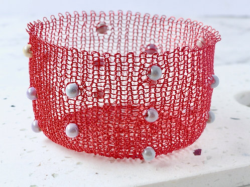 Red knitted basket with silver beads