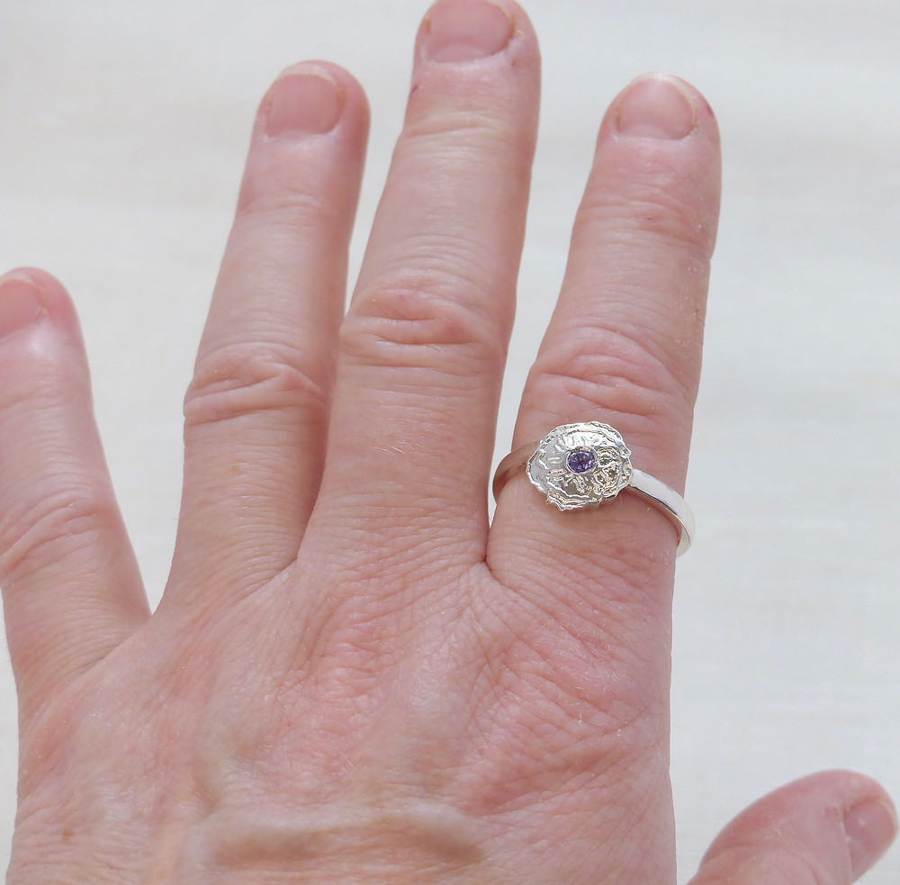 Pretty etched design ring with loite centre stone