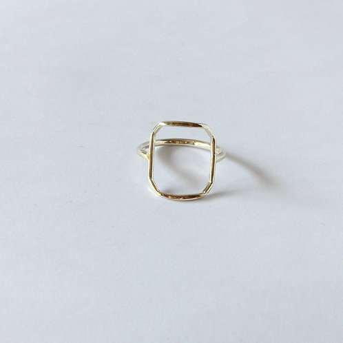 Silver geometric shape ring. Rectangular with soft corners. Clean simple design.