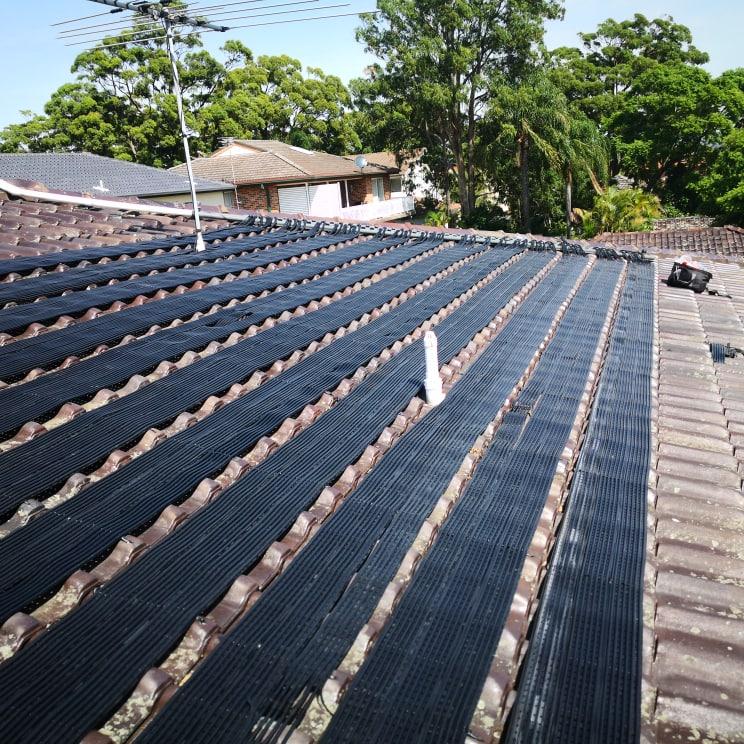 Solar pool heating matting installed on roof
