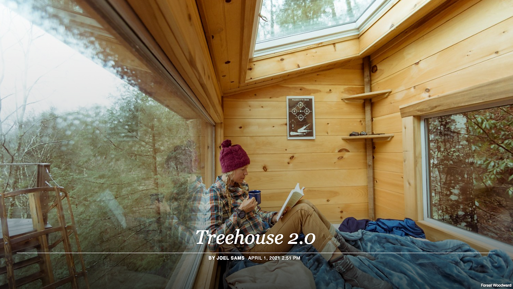 Woman relaxing in a treehouse