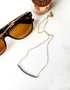 flat lay - tigers eye necklace with sunn