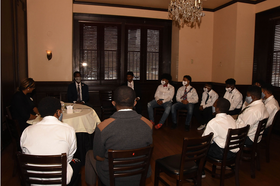 Eastlake Male Youth Initiative students gather together for a lesson on dining etiquette.