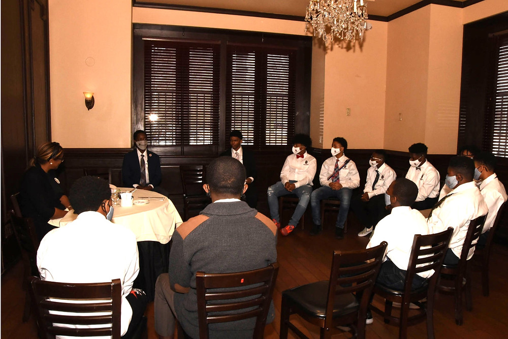 Students receive instruction on fine dining