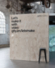 """Shot of an event activation stand for Getty Images. A large plywood temporary wall with the text """"Let's make it with video gtty/im/letsmake"""""""