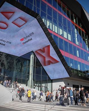 external shot of the ICC Sydney wih TEDxSydney promotional screens and people gathering out the front
