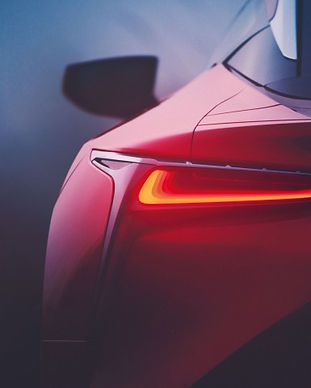 Artists impression of the brake lights on a red Lexus sports car