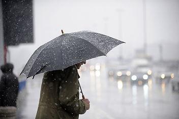 Man in rain with Umbrella