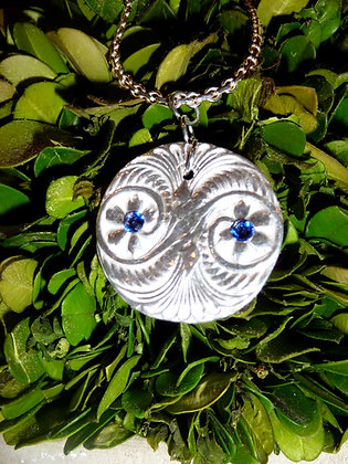 Silver pendant with sapphire crystals