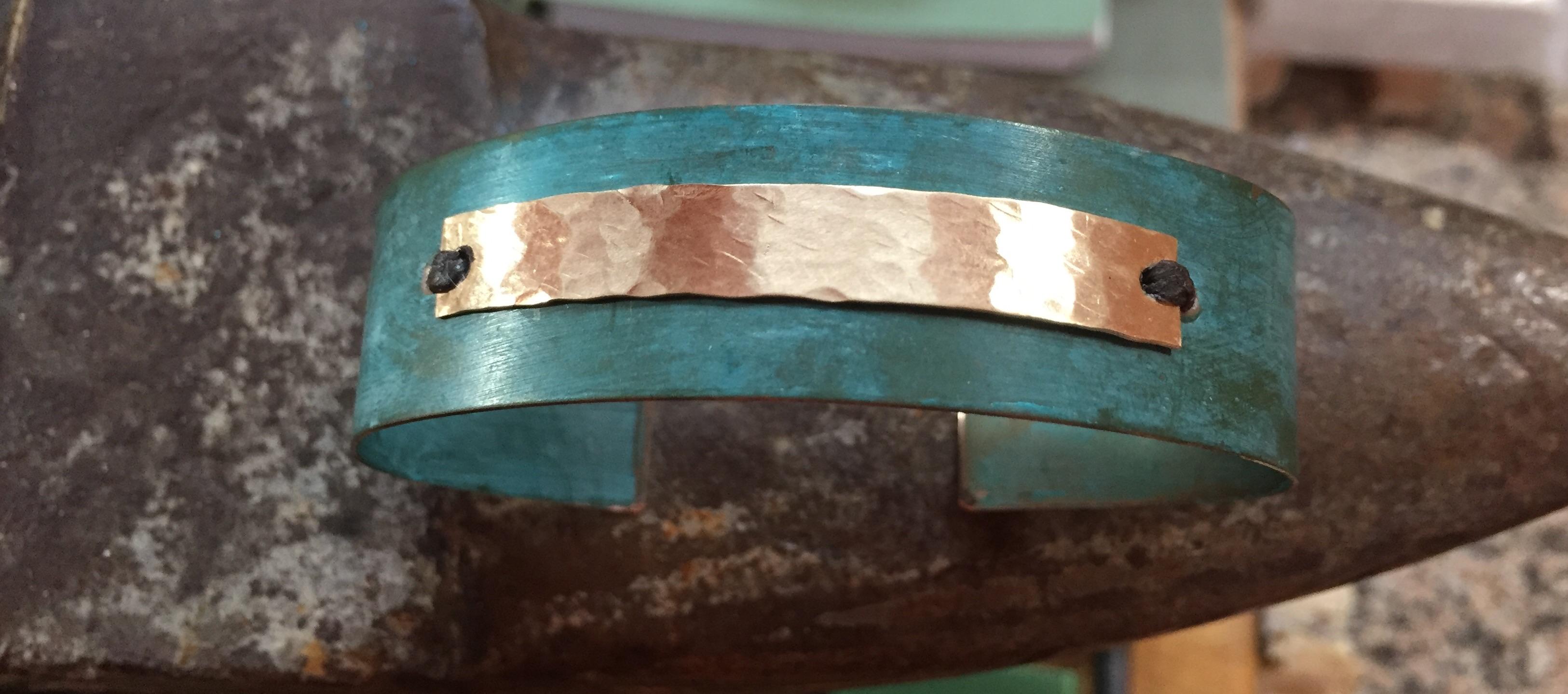 Copper patina cuff with brass accent