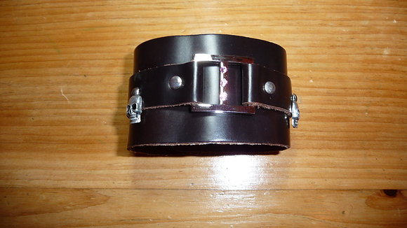 Brown leather cuff with crystals and skulls
