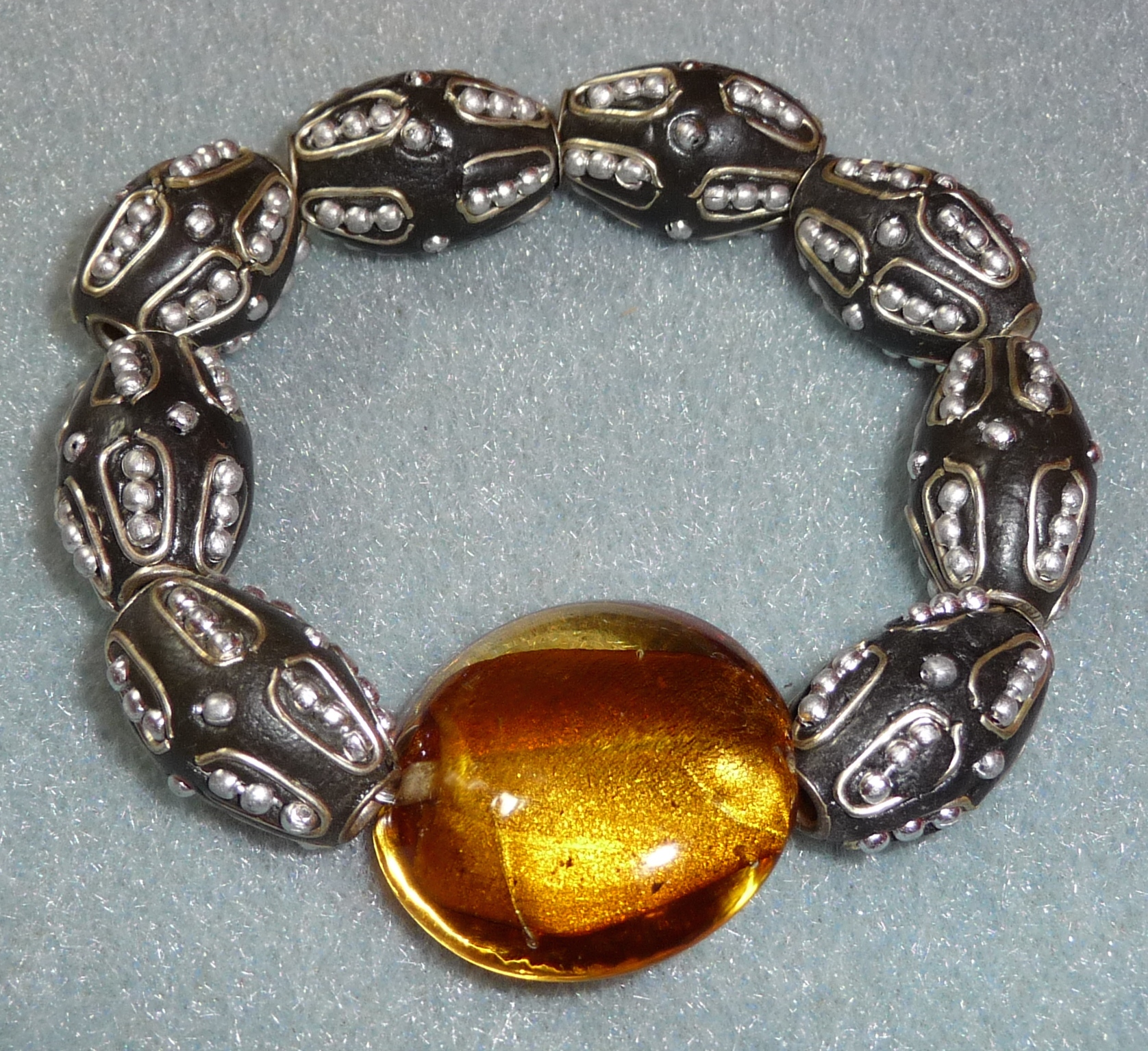 Warm amber jewel with eclectic beads