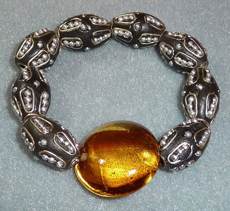 Warm amber gem surrounded by eclectic beads