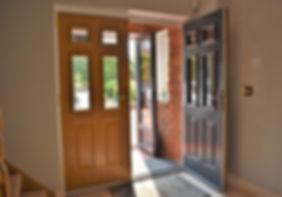 Double doors, double front doors, porch doors, big porch, porch construction, hallway, doorway, house extension, porch extension