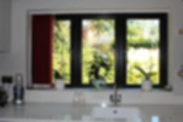 uPVC window in black installed Hayley Windows truste supplier of uPVC windows, doors, Bifolds, composite doors, conservatories, extensions in The West Midlands New upvc windows and doors, high quality replacemet windows and doors colour frames in Pedmore, Norton, Stourbridge window installers, Pedmore window installers, supply and install hg qualiy windows and doors stourbridge