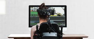 Girl with Cerebral Palsy creating a movie on her computer