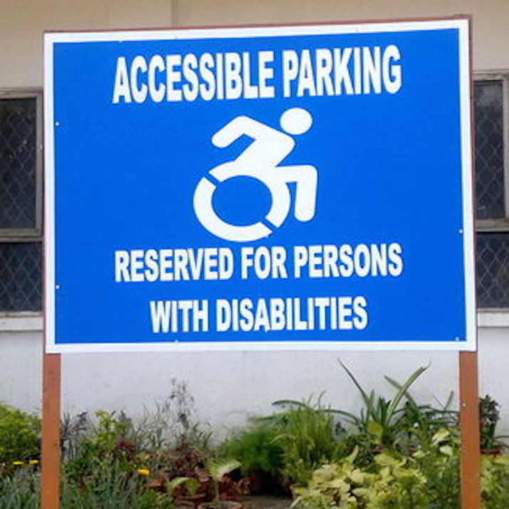 Accessible Parking Sign with replaced Logo