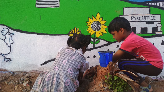 Children working on our community mural