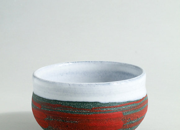 Sea green teabowl with red slip and dolomite glaze