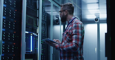 Adult bearded system administrator in gl