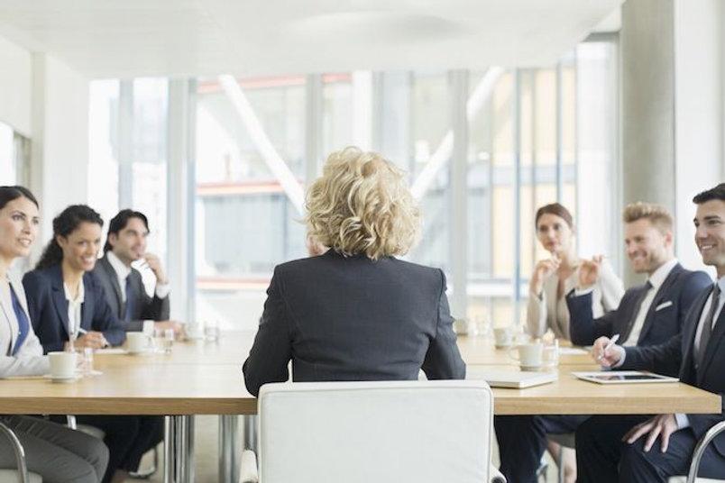 woman-board-meeting-457979149-martin-bar