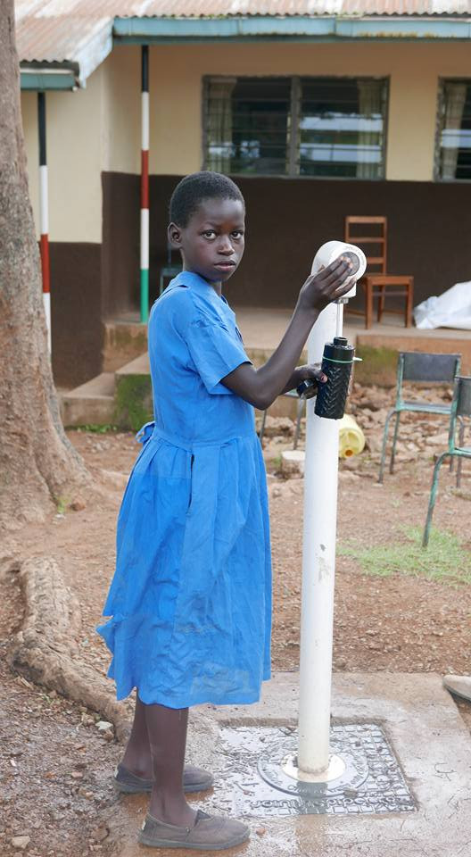 water kiosk tap young girl
