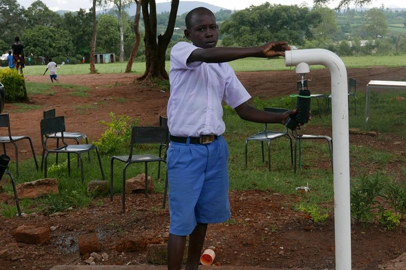 water kiosk tap filling bottle