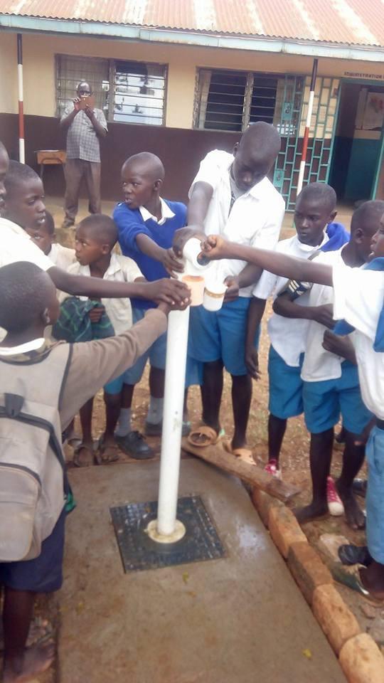 water kiosk tap children kenya