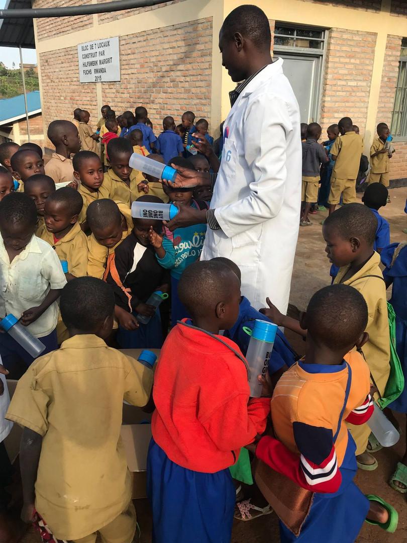 water kiosk giving bottles children