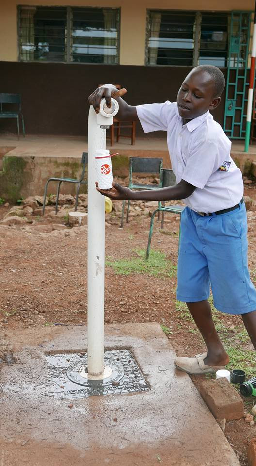 water kiosk tap young boy