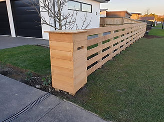 Letterbox and fence using Garapa decking.jpg
